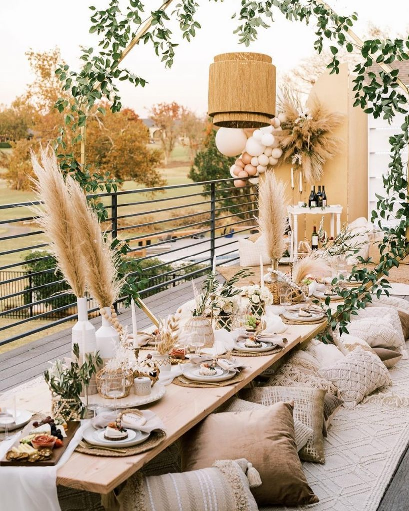 Complete with cozy floor pillows and the dreamiest bohemian tablescape we ever did see, this decadent boho styled Friendsgiving dinner