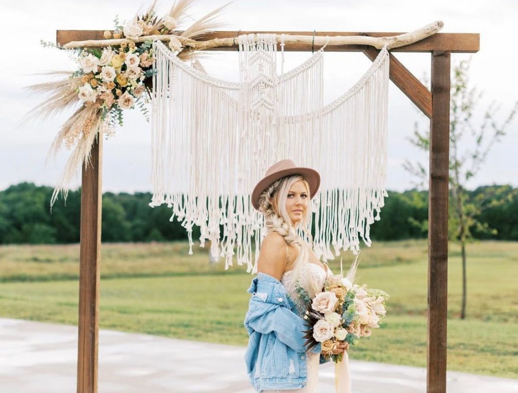 Boho brides look no further! Between the seriously impressive macrame backdrop and naturally-relaxed beauty look, you'll want to put down