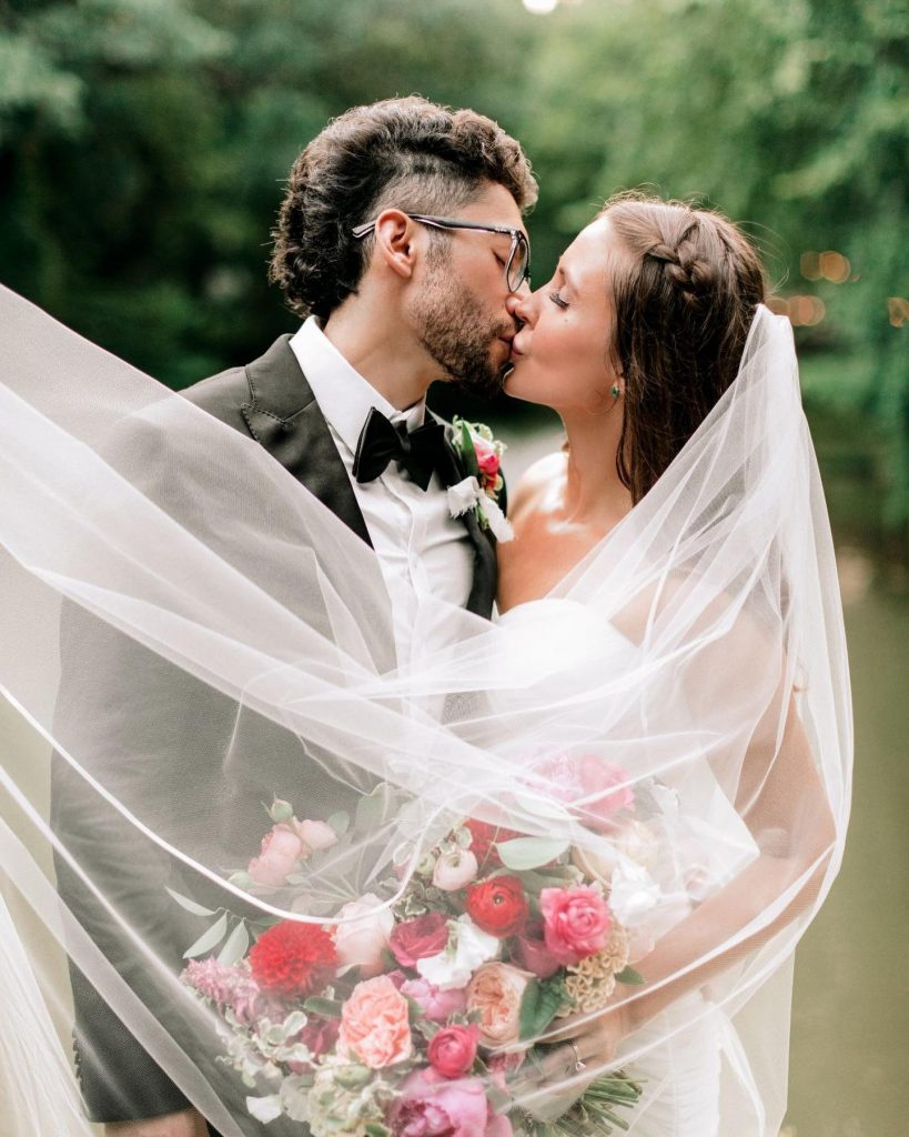 McClayn + Beto tied the knot in an intimate, modern elopement featuring the prettiest bold pink flowers, all planned beautifully