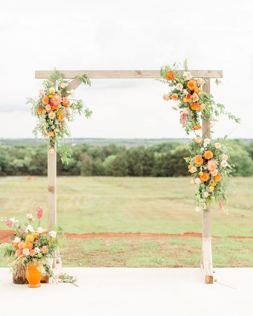 """From the florist, Callie Schmidt of theflowershoppryor: """"This colorful garden styled shoot was so bright and fun! I loved the"""