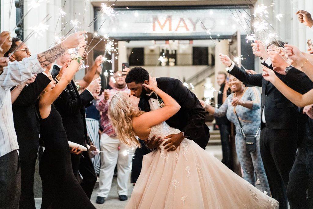 """""""Since Brandin and I met at Disney, we incorporated little hidden Mickeys throughout our ceremony, reception, and even in the"""
