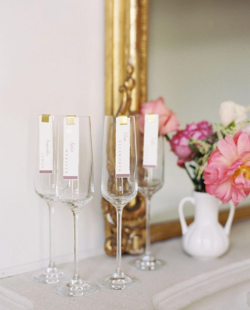 What makes sipping bubbly *even* better? Sipping in style, of course! These escort cards and clips from chirpsandcheers are the