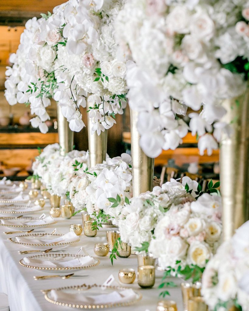 Ashton and Chad's gold and white destination wedding in Ridgedale, Missouri, looked as if it was planned for royalty! This